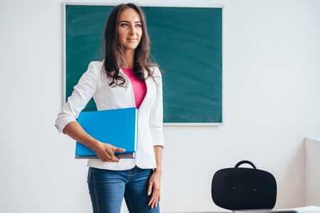 Photo pour Young teacher or student smiling and looking at camera. - image libre de droit