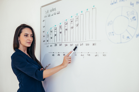 Photo pour Business woman showing presentation on magnetic desk - image libre de droit