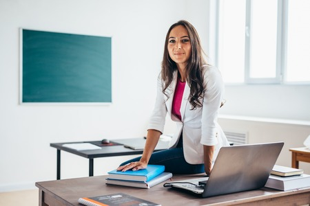 Photo for Portrait of female college teacher smiling at camera - Royalty Free Image