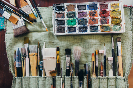 Photo for Art supplies. Brushes different types for drawing, watercolor paints. - Royalty Free Image