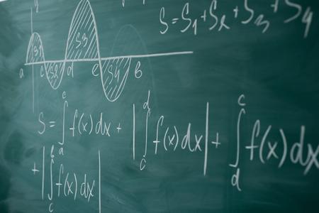 Foto de Math class. Algebra. Graph and formulas are written on the school board - Imagen libre de derechos