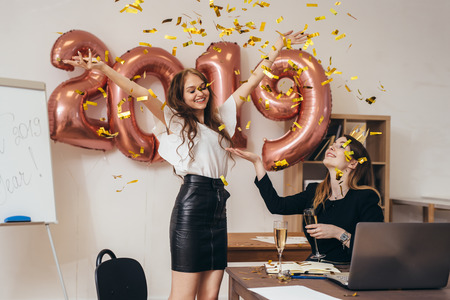Photo for Group of business women having party at office. Xmas, Christmass, New Year. - Royalty Free Image