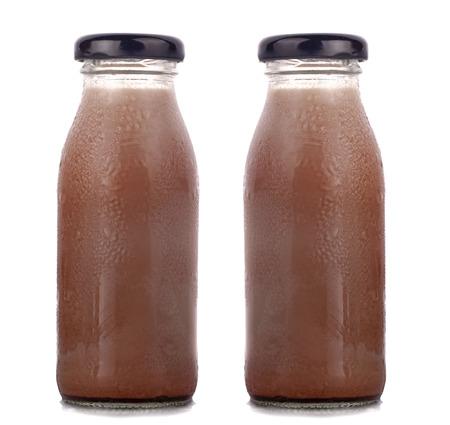 Foto de Various flavors of milk in bottles with chocolate  - Imagen libre de derechos