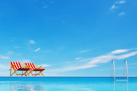 Photo for Swimming pool with beach chairs  - Royalty Free Image