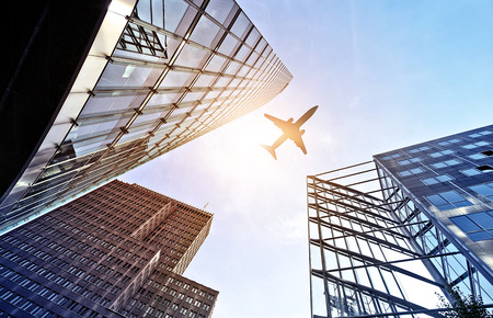 Photo pour plane flying over modern glass and steel office buildings near Potsdamer Platz, Berlin, Germany - image libre de droit
