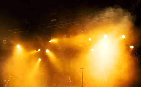 Photo for Various orange stage lights in the dark - Royalty Free Image