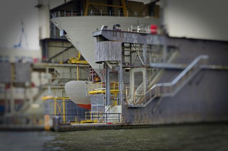 Photo for Dry dock or shipyard with ship at Hamburg harbor at repair work in Hamburg in Germany Europe - Royalty Free Image
