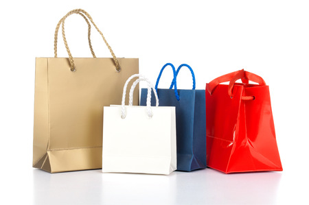 Photo for Assorted shopping bags including red, gold, blue on a white background - Royalty Free Image