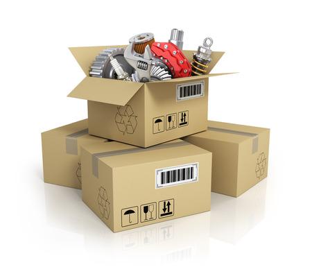 Foto de Auto parts in the cardbox. Automotive basket shop. Auto parts store. - Imagen libre de derechos