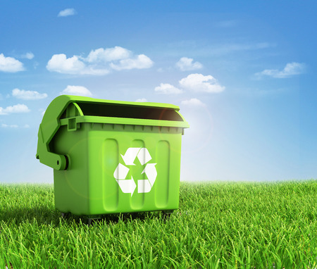 Photo for Green plastic trash recycling container ecology concept, with landscape background. - Royalty Free Image