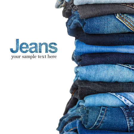 Photo for stack of various shades of blue jeans on white background - Royalty Free Image