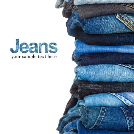 Foto de stack of various shades of blue jeans on white background - Imagen libre de derechos