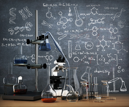 Foto de Chemistry laboratory concept. Laboratory chemical test tubes and objects on the table with chemistry draw on whiteboard. - Imagen libre de derechos