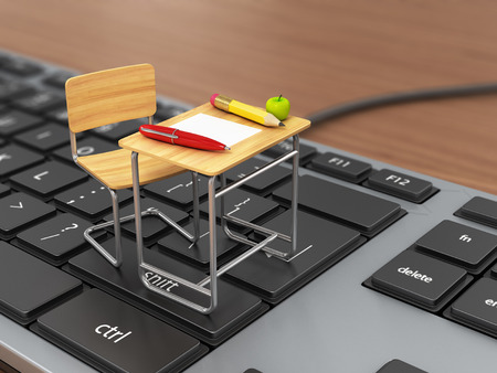 Foto de School desk and chair on the keyboard. Online traning concept. - Imagen libre de derechos