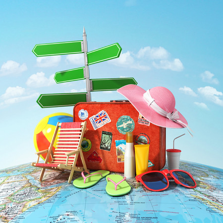 Foto de Recreation and travel concept. Road sign old suitcase for travel beach hat beach ball sunglasses sun cream and beach shoes on the world map and blue sky. Direction to recreation. - Imagen libre de derechos