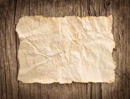 Photo for Old paper on the wood background - Royalty Free Image