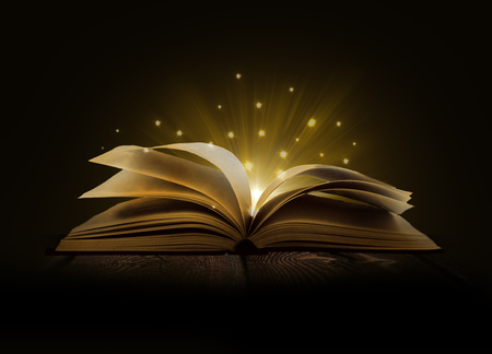 Photo for Image of opened magic book with magic lights - Royalty Free Image