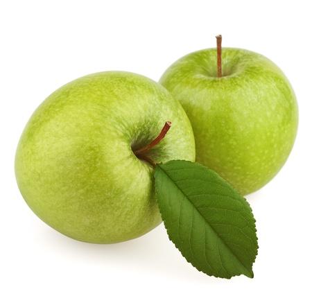 Foto de Two green apple fruits with leaf isolated on white background - Imagen libre de derechos