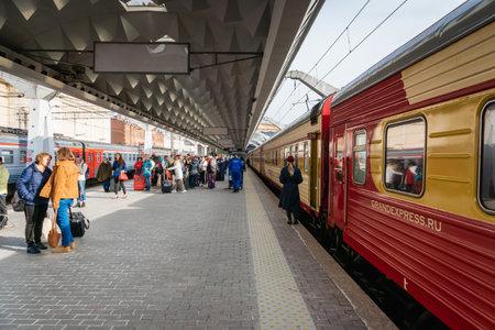 Foto per Saint Petersburg, Russia - May 2019: Grand Express night train at the platform in Saint Petersburg Moscau train station. Grand Express is a luxury night train that travels Moscow - St. Petesburg. - Immagine Royalty Free