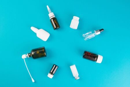 Photo for Different vials and sprays with medicines are laid out in the form of a circle. Top views with clear space. - Royalty Free Image