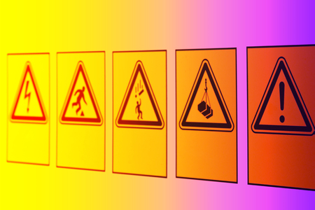 Photo pour Warning signs in the form of a triangle of different symbols on the information Board near the construction site. - image libre de droit