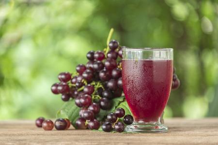 Foto de Grape juice in a glass on the table. - Imagen libre de derechos