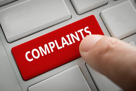 Photo pour Close view of male hand touching the complaints button. complaints concept. - image libre de droit