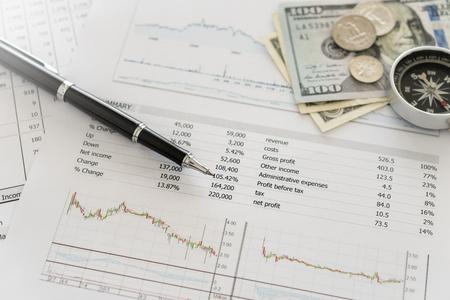 Foto de financial planning, finance, investment, diagrams graphs and numerals on the business report and money, compass. - Imagen libre de derechos