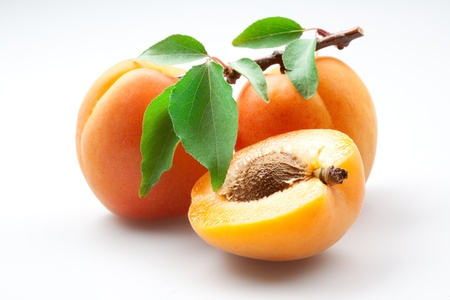 Photo for Apricots with leaves on white background, isolated - Royalty Free Image
