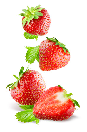 Foto de Falling strawberries. Isolated on a white background. - Imagen libre de derechos