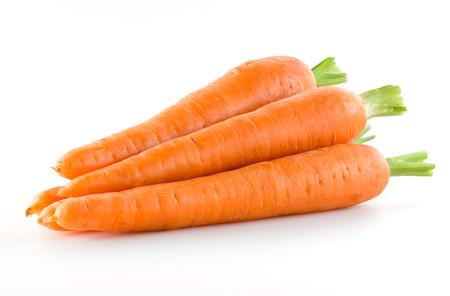 Foto de Carrot. Heap of vegetable isolated on white - Imagen libre de derechos