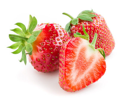 Foto de Strawberry. Berries with a half isolated on white - Imagen libre de derechos