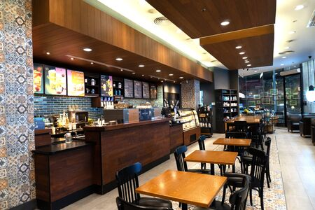 Photo for Pattaya, Thailand, August 19, 2019. Starbucks cafe late in the evening with no people. Good place for working and meeting with friends or for business. Good photo for banner for web site - Royalty Free Image