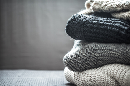 Photo pour A stack of knitted sweaters ,the concept of warmth and comfort, hobby , background,closeup - image libre de droit
