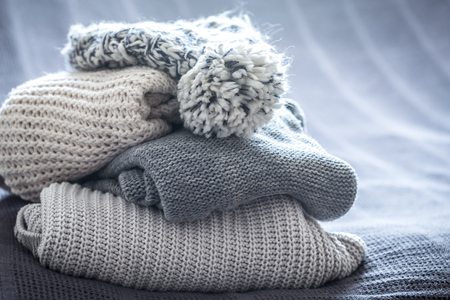 Foto de beautiful knitted clothes, neatly folded, close-up, handmade knitted sweaters - Imagen libre de derechos