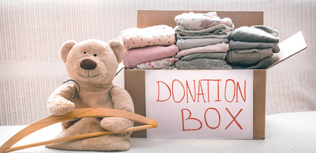 Foto de Box with clothes for charity, concept of social projects - Imagen libre de derechos