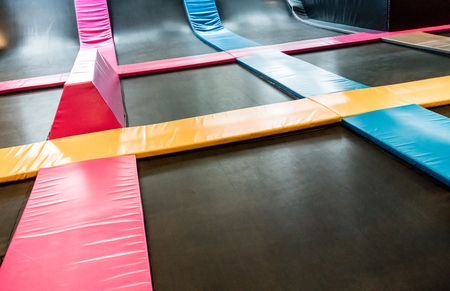 Foto de Interconnected trampolines for indoor jumping. New revolution playground and fun activity for all ages. - Imagen libre de derechos