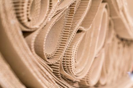 Foto de Roll of wavy craft paper folded in random. Single faced corrugated paper best useful for decoration. Selective focus - Imagen libre de derechos