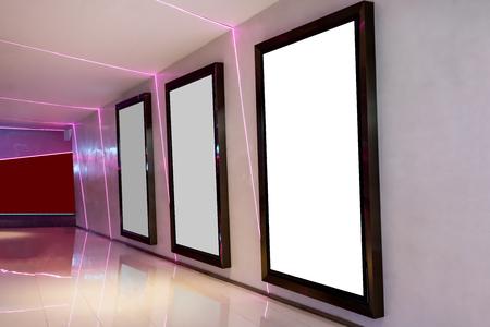 Foto de Three movie poster frames along the walkway in modern interior design for movie theater - Imagen libre de derechos