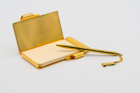 Photo for Gold personal vintage notebook case with pen isolated on white background. - Royalty Free Image