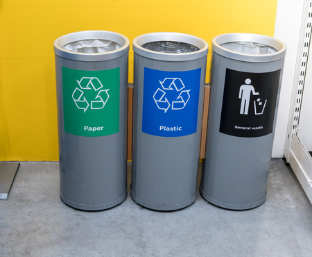 Photo pour Different color trash cans in row for waste management. Perspective disposal view for saving environmental concept. - image libre de droit