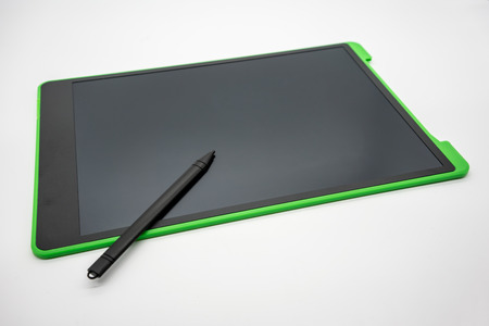 Foto für Black and green LCD writing pad tablet isolated on white background - Lizenzfreies Bild
