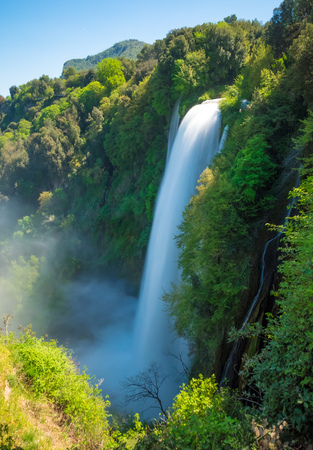 Photo pour Marmore (Terni), Italy - 21 April 2018 - The 'Cascata delle Marmore' is a touristic park with a man-made waterfall created by the ancient Romans. The fall of Velino river in total is height 165 meters. - image libre de droit