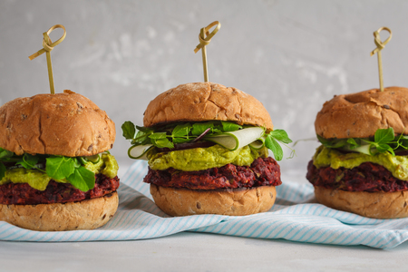 Photo for Vegan beet burgers with vegetables, guacamole and rye bun with green juice. Healthy vegan food concept. - Royalty Free Image
