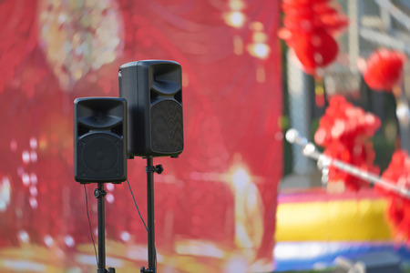 Photo for speakers and stand in front of stage ,concert show outdoors daytime - Royalty Free Image