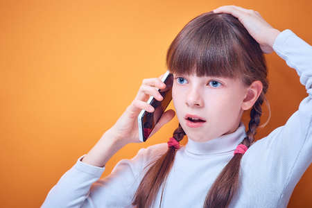 Foto de technology and communication, Caucasian teen girl talking on the phone on a colored background, place for text - Imagen libre de derechos