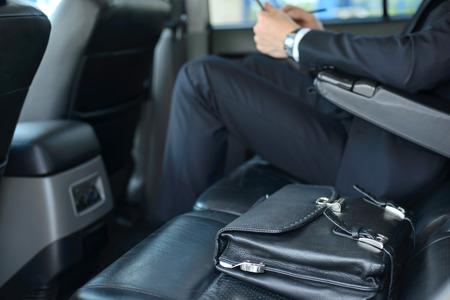Foto de Young successful businessman riding in the car - Imagen libre de derechos