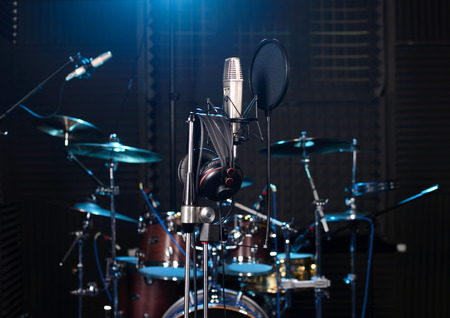Photo for Studio room with drum set, microphones and recording equipment. - Royalty Free Image