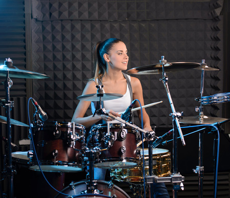 Photo for Girl behind drum-type installation in a professional recording studio - Royalty Free Image