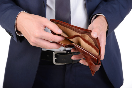 Photo for Businessman well-dressed with empty wallet, no money - Royalty Free Image